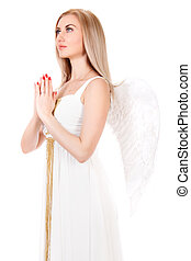 Beautiful praying young woman in a white dress with angel wings