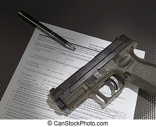 Handgun and paperwork - Form to check the background of a...