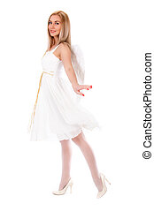 Beautiful young woman in a white dress with angel wings...