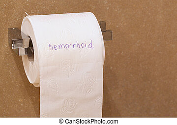 The word haemorrhoid is written on a paper - The word...