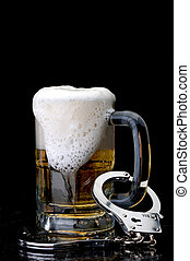 Vertical image of handcuffs on the handle of a beer mug :...