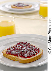 Morning breakfast with orange juice and jam or jelly on...