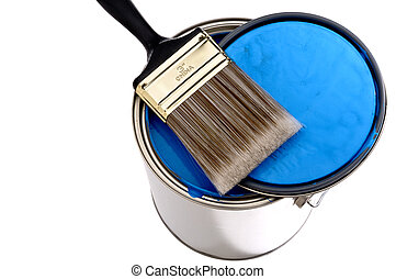 Paint brush and lid ontop of a can of blue  paint