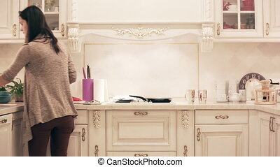 girl preparing a meal in the kitchen. time lapse - pretty...