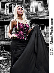 Woman at the background of the abandoned house - Gorgeous...