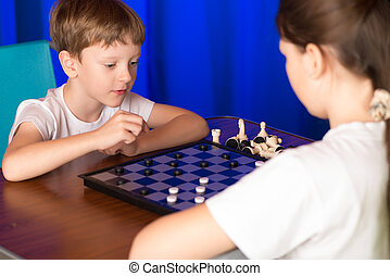 Children boy and girl playing a board game - Children play a...