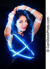 Beautiful woman with fairy lights - Beautiful young woman...