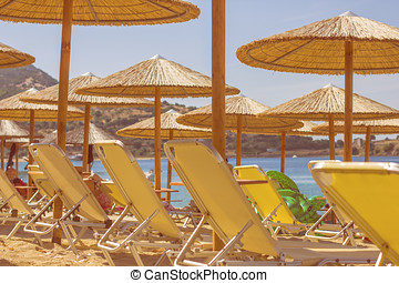 Summer Travel Destination Beach - Sunshade and chairs on...