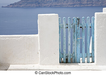 Blue Gate - Blue gate on the volcanic island of Santorini,...