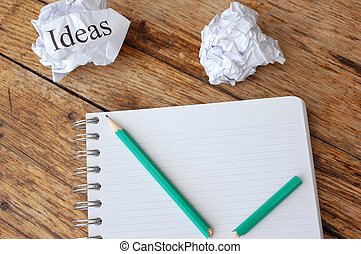 Writers block - Ideas written on a crumpled piece of paper...