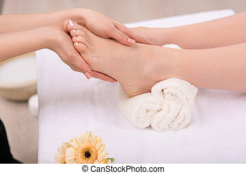 Nice woman having foot treatment - Receive satisfaction...