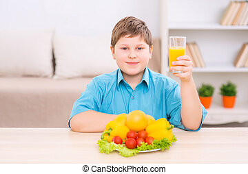 Chubby kid with juice and veggies - Healthy diet Chubby boy...