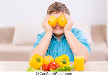 Chubby kid playing with oranges - Orange eyes Chubby boy is...