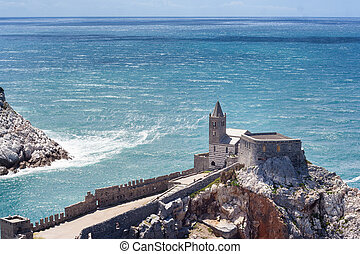 Portovenere view of the canall and Saint Peters church -...