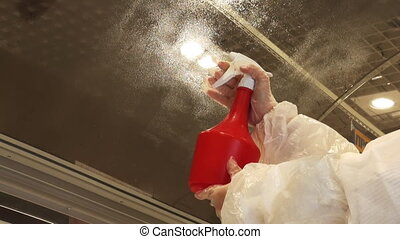 Cleaning glass windows in a supermarket. Cleaning of...