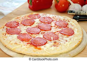 Pizza - Closeup of delicious pepperoni pizza