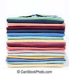 Stack of colourful t-shirt