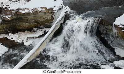 Snowy McCormicks Creek Falls Loop - Water rushes over a...
