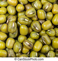 raw green mung beans close up - square food background - raw...