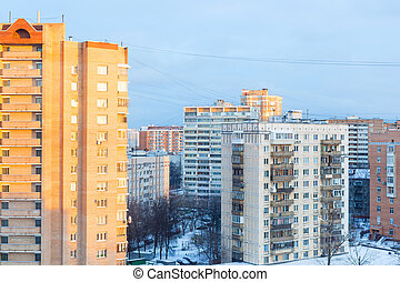 sunrise over residential district in winter