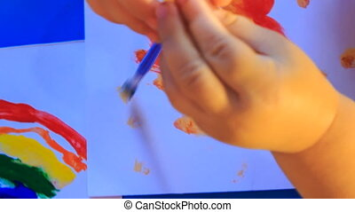 Kid's Hands Paint Green Spots with