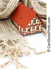 house with scarf symbolfoto insulation - a model house is...