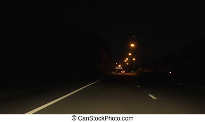 Driving motorway at night - Highway view from inside a car...
