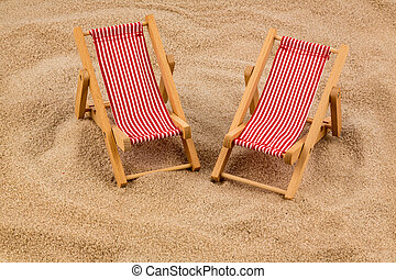 deckchair on sandy beach - a small deck chair model on a...