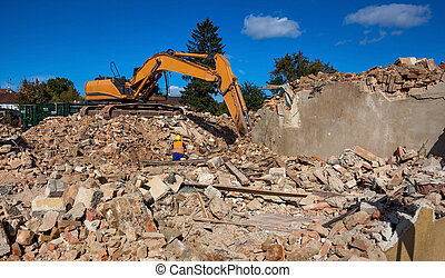 abbruchhaus - a house is demolished excavator on the...