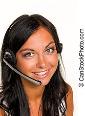 woman with headset - a young woman in an mcc phoned customer...
