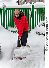 shoveling snow at man - a man shoveling snow from a new way...