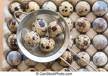 quail eggs in a frying pan,on wooden table