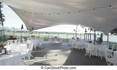 Tables set for outdoor wedding party