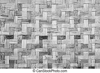 Wall of plaited bamboo strips vernecular outdoor grey scale...
