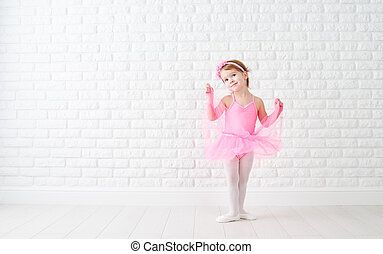 little child girl dreams of becoming ballerina in a pink...