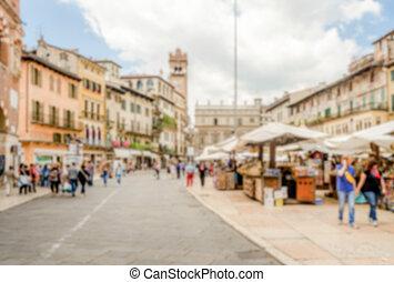 Defocused background of Piazza delle Erbe, Verona, Italy....