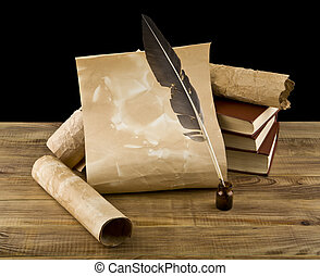 old books and pen on a black background