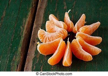 Orange mandarin divided to pieces - Horizontal photo with...