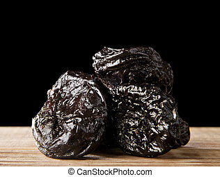 prunes on a black background