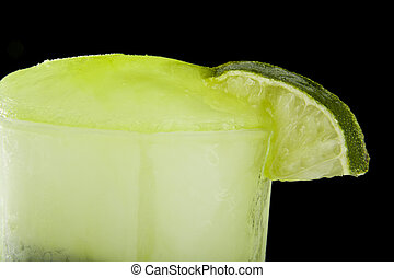 frozen lime juice on a black background