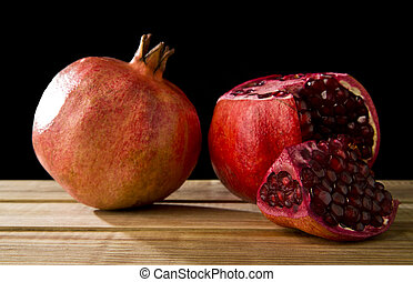 juicy pomegranate on a black background