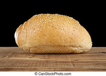loaf on a black background