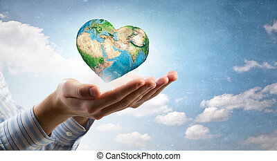 Future of our planet in your hands - Close up of human hands...