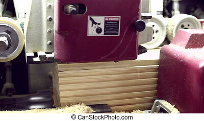 View on profiled timber processing at machine, close-up