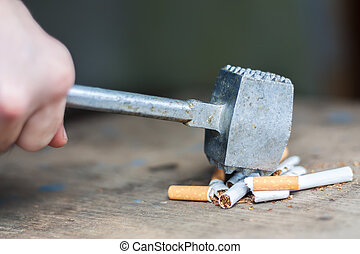 Human hands breaking the cigarettes - Quit smoking, human...