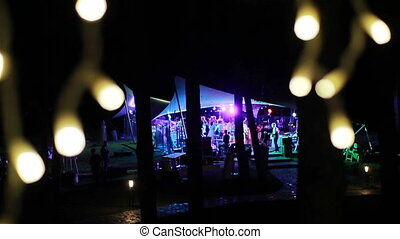 People dance at outdoor night party