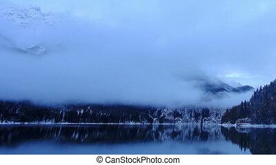 Sunset on an alpine lake Ritsa
