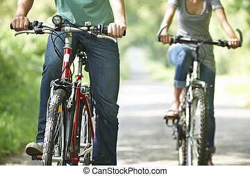 Close Up Of Couple On Country Cycle Ride