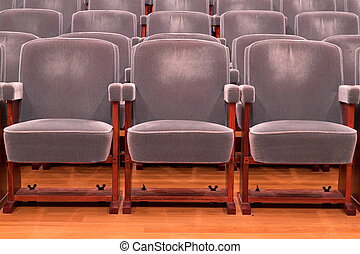 Grey theater seats - Rows of grey theater seats in a concert...
