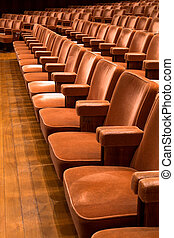Brown theater seats - Rows of brown theater seats in a...